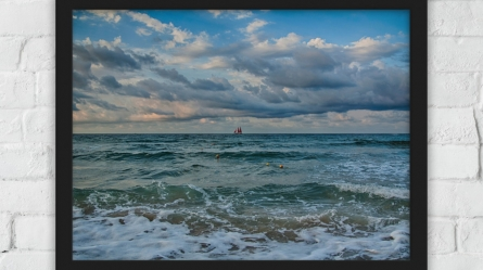 Lonely red ship between Black sea and the clouds